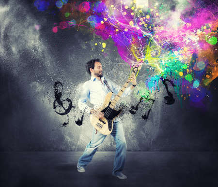 Boy play with bass guitar with colorful effect photo