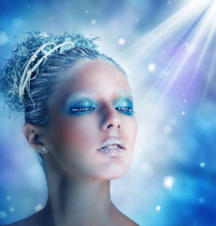 snow woman: Winter makeup of a beautiful woman portrait