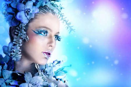 Winter makeup of a beautiful woman portrait photo