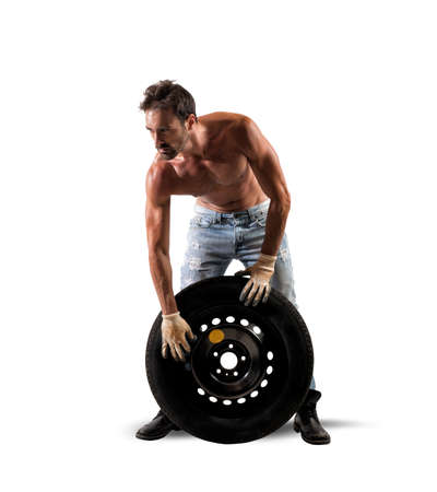 Tire repairer service concept with sexy mechanic photo