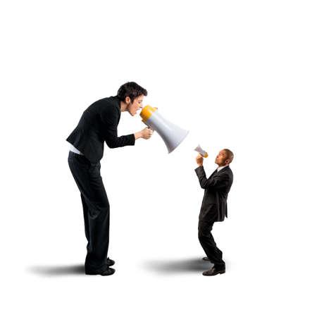 discredit: Businesswoman shouting a businessman through a megaphone Stock Photo