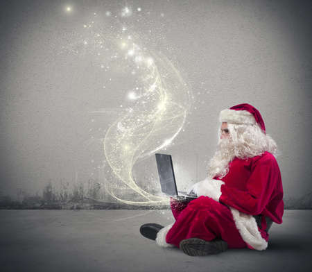 laptops: Santa Claus surfs on internet with a laptop