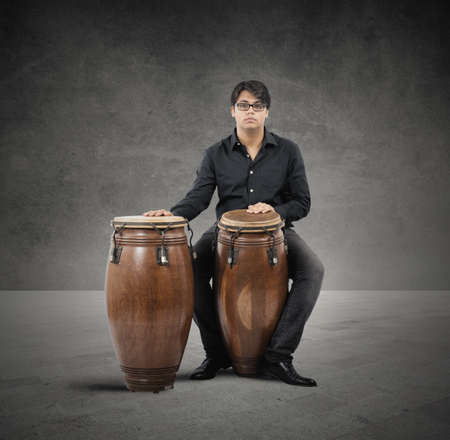 bongo drum: Young percussionist ready to play with his instrument Stock Photo
