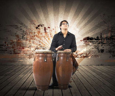 percussionist: Young percussionist playing with his instrument Stock Photo