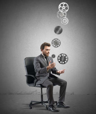 failed strategy: Concept of business game with juggler businessman with gear Stock Photo