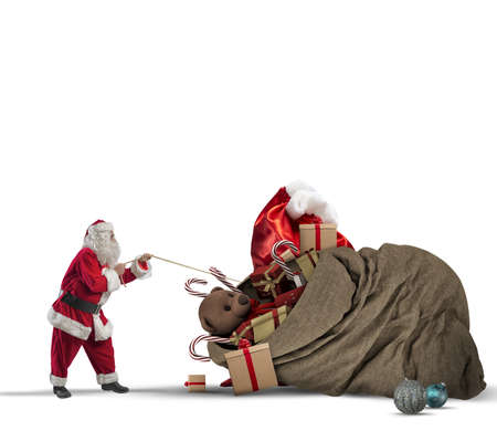 santaclaus: Santaclaus pull a beautiful big gift bag Stock Photo