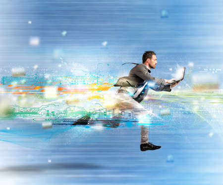 Concept of fast internet with running businessman with a laptop Stock Photo - 33565276