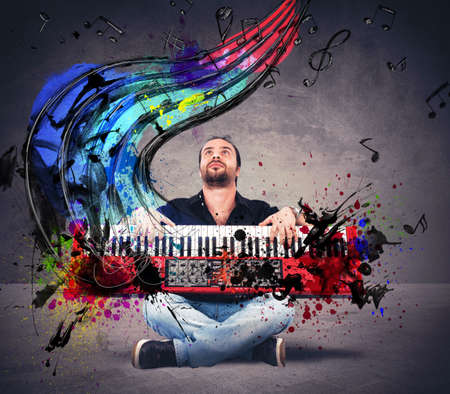 Musician plays the piano with colorful notes Stock Photo