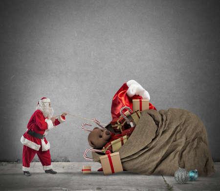 santaclaus: Santaclaus pull a beautiful big gift bag Stock Photo