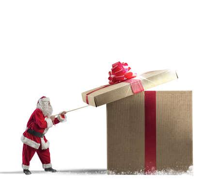 box big: Santa Claus opening a big red gift Stock Photo