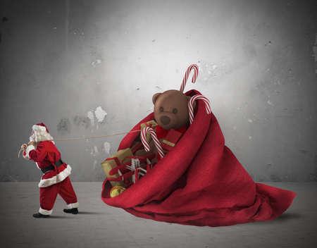 Santa Claus pulls a big sack of presents photo