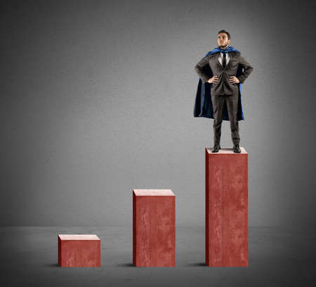 invincible: A brave businessman hero above the statistic Stock Photo