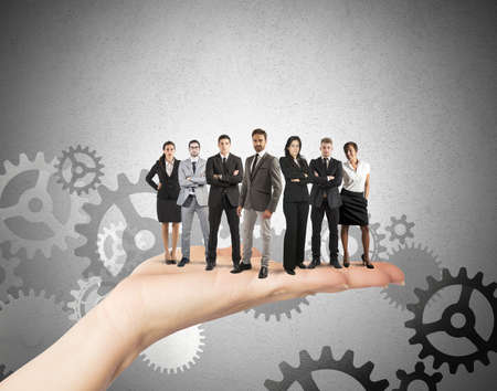 Concept of Teamwork and integration with businessperson over the hand