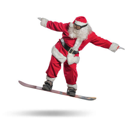 Funny santa claus goes fast on a snowboard