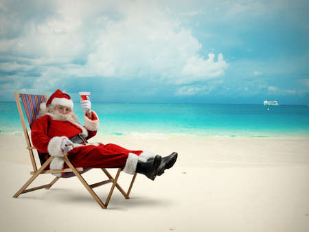 Santaclaus relaxes in a deckchair on beach
