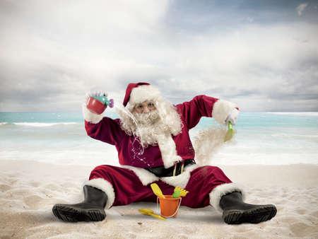 children santa claus: Santa Claus enjoys playing on the beach