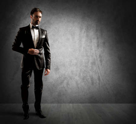 tuxedo jacket: A businessman wearing an elegant black tuxedo