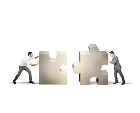 merging: Teamwork and partnership concept of two businessman Stock Photo