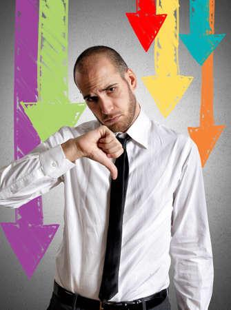 Businessman sad for negative results at work photo