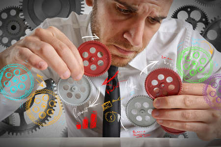 Businessman to build a system with gears
