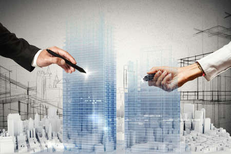 building structures: People business draws a project in 3D Stock Photo