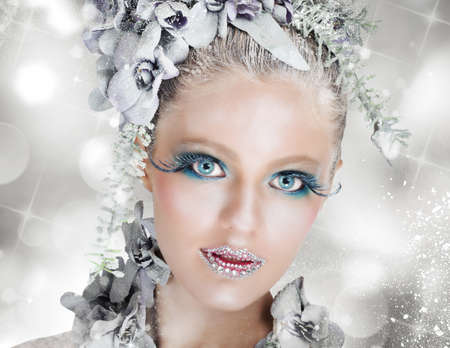 Sparkling makeup fairy snow with icy flowers photo