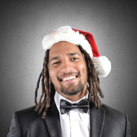 rasta hat: A smiling businessman with rasta celebrates Christmas Stock Photo