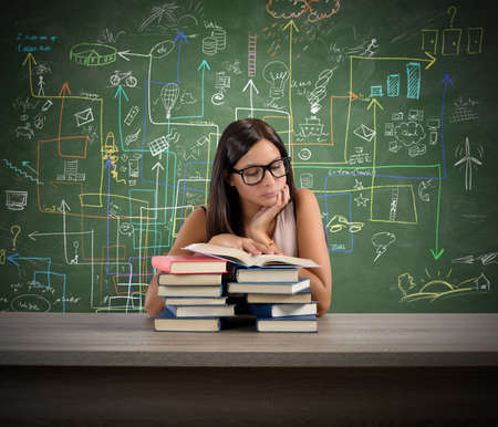 concentrated: A young teacher concentrated reading a book Stock Photo
