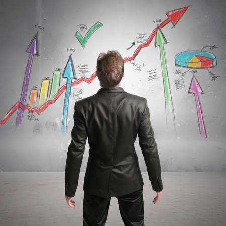 ascend: Businessman watchs successful statistics of a company