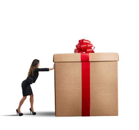 box big: A businesswoman pushing a big Christmas gift