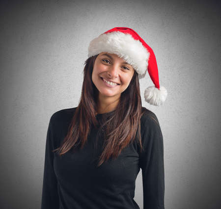 santaclaus: Smiling businesswoman wearing the hat of SantaClaus Stock Photo