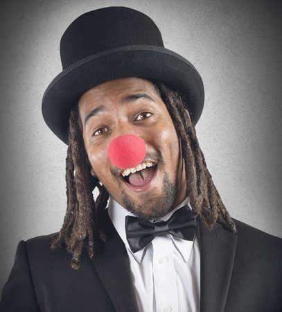 rasta hat: Elegant clown smiles with his red nose Stock Photo