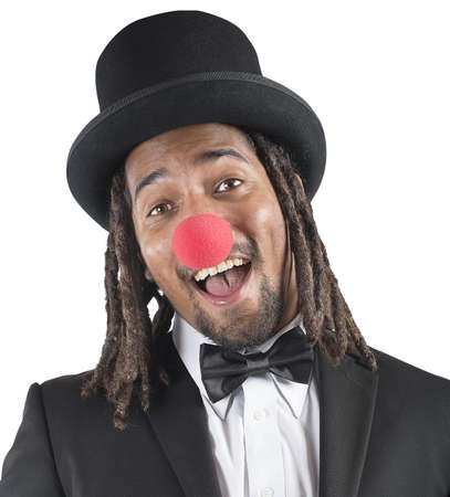 unprofessional: Elegant clown smiles with his red nose Stock Photo