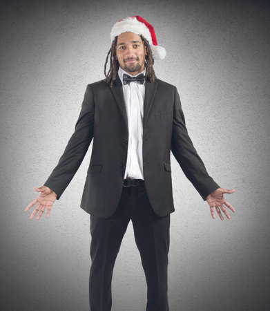 santaclaus: Businessman celebrating Christmas with his santaclaus hat Stock Photo