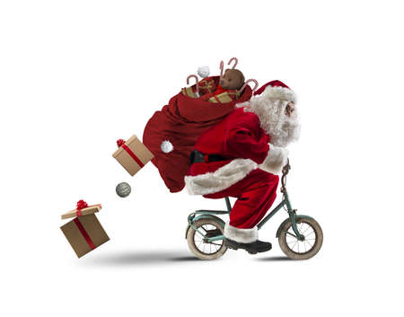 ironic: Santaclaus delivering gifts with a small bicycle