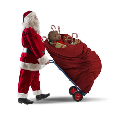 Santaclaus as a courier with Christmas gifts Stock Photo