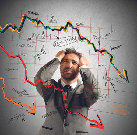 Zakenman uitgevoerd door de financiële ineenstorting benadrukte Stockfoto - 34404533