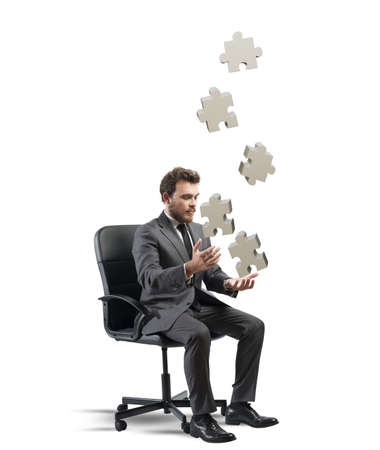 failed strategy: Concept of business game with juggler businessman with puzzle Stock Photo
