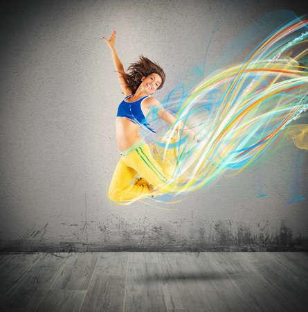 Dancer jumps leaving a strip of colors
