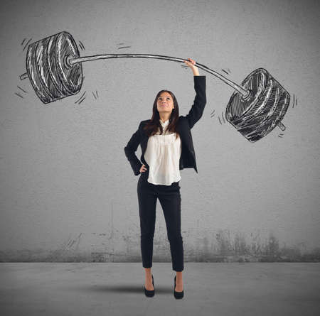 A businesswoman solves lightly every weight work