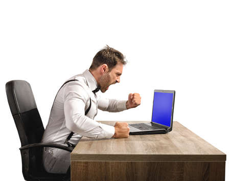 agression: Stressed and angry businessman work at laptop