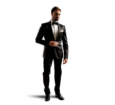 A businessman wearing an elegant black tuxedo