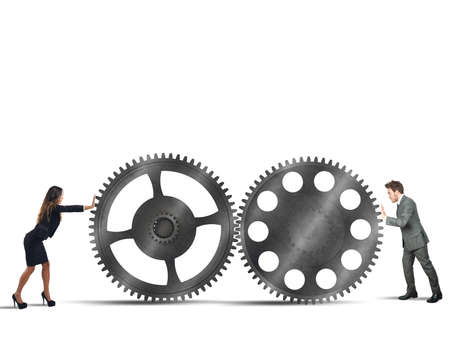 energy work: Businesspeople working together for perfect interlocking gears Stock Photo