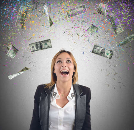 win money: Happy businesswoman have earned lot of money
