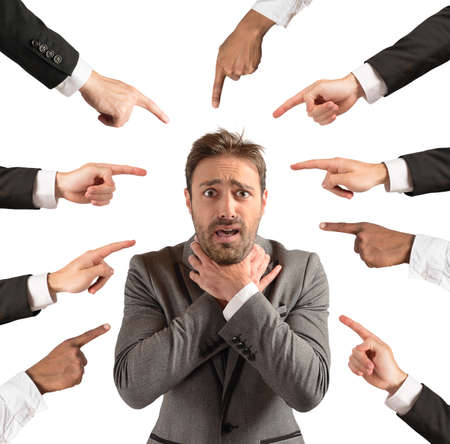 accused: Businessman accused and insulted by his team Stock Photo