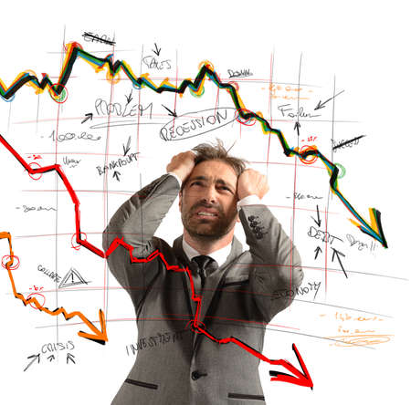 Businessman stressed out by the financial collapse Stockfoto