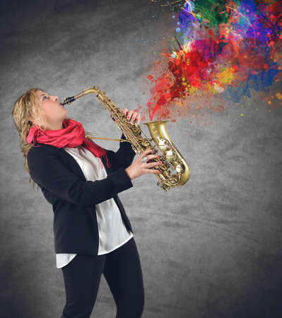 Woman plays beautiful notes from her saxophone photo