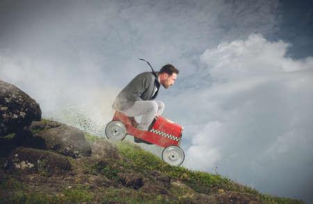 juguetes: Empresario jugando con el coche y va hacia abajo Foto de archivo
