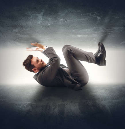 fear of failure: Businessman crushed by the problems and stress