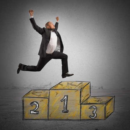 businessman jumping: A businessman jumping on the work podium